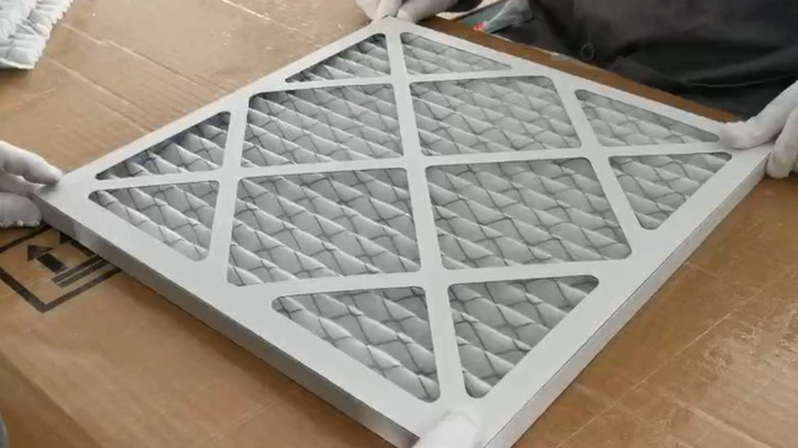 Primary effect paper frame air filter assembly